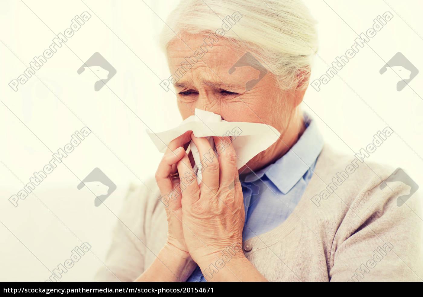 sick, senior, woman, blowing, nose, to - 20154671
