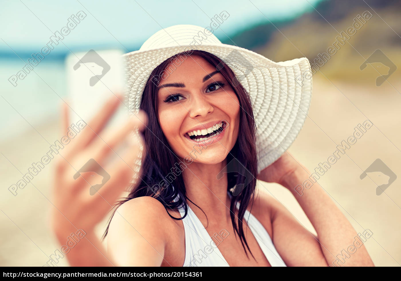 smiling, young, woman, taking, selfie, with - 20154361