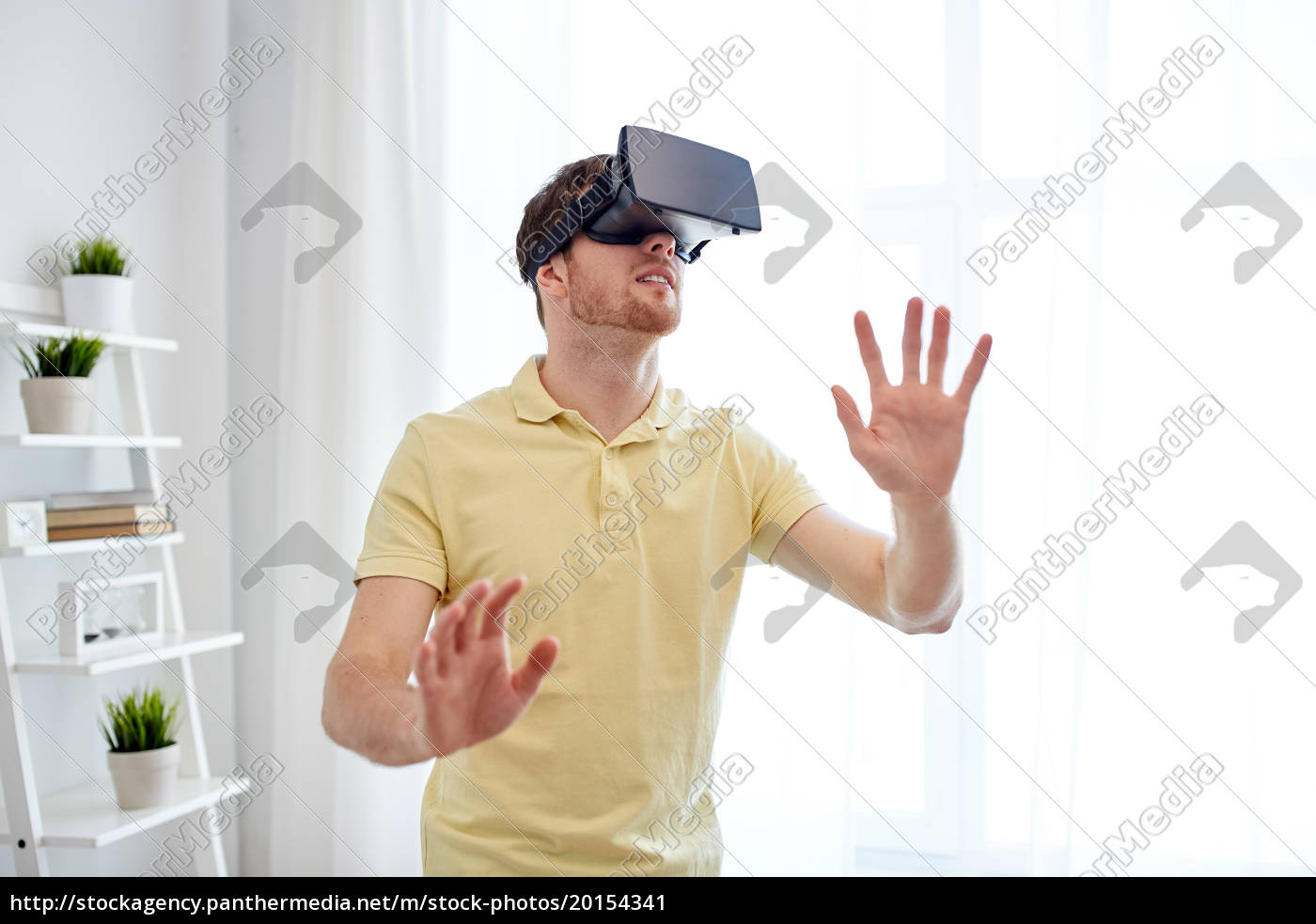 young, man, in, virtual, reality, headset - 20154341