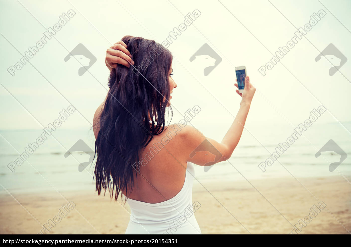 young, woman, taking, selfie, with, smartphone - 20154351