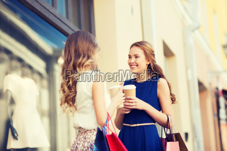young, women, with, shopping, bags, and - 20154601