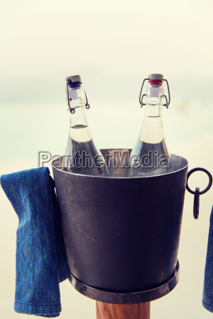 water bottles in ice bucket at