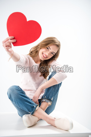 woman with paper heart