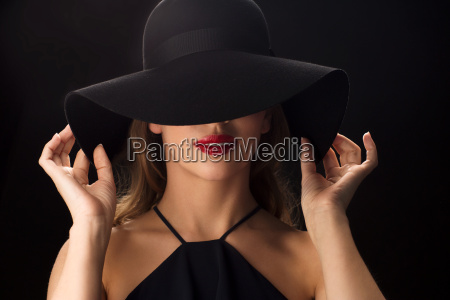 beautiful, woman, in, black, hat, over - 20169357
