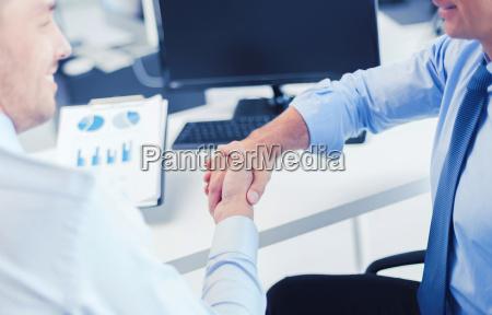 businessmen, shaking, hands, in, office - 20169425