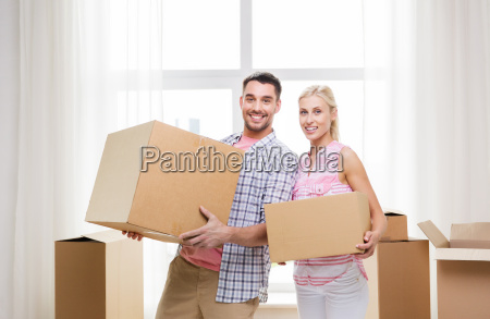 couple, with, big, cardboard, boxes, moving - 20169445