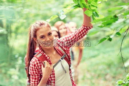group, of, smiling, friends, with, backpacks - 20169453