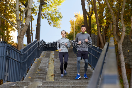 happy, couple, running, downstairs, in, city - 20169333