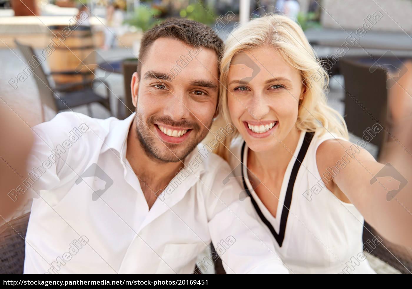happy, couple, taking, selfie, at, restaurant - 20169451