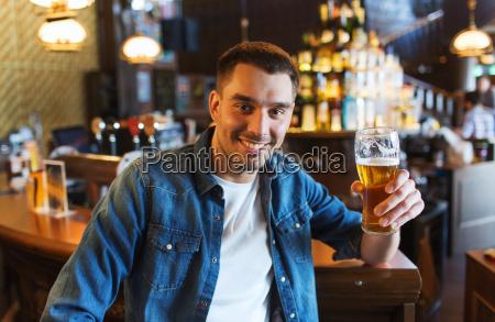 happy, man, drinking, beer, at, bar - 20169779