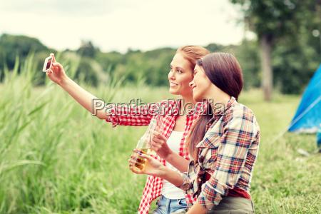 happy, women, taking, selfie, by, smartphone - 20169475