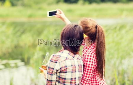 happy, women, taking, selfie, by, smartphone - 20169661