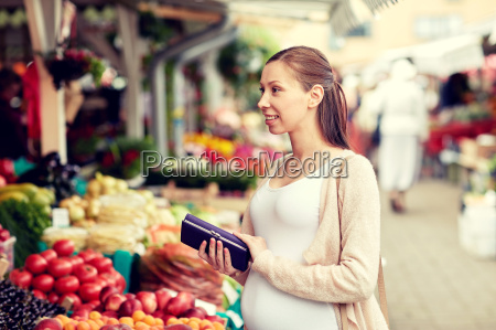 pregnant, woman, with, wallet, buying, food - 20169987