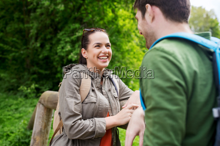 smiling, couple, with, backpacks, in, nature - 20169471