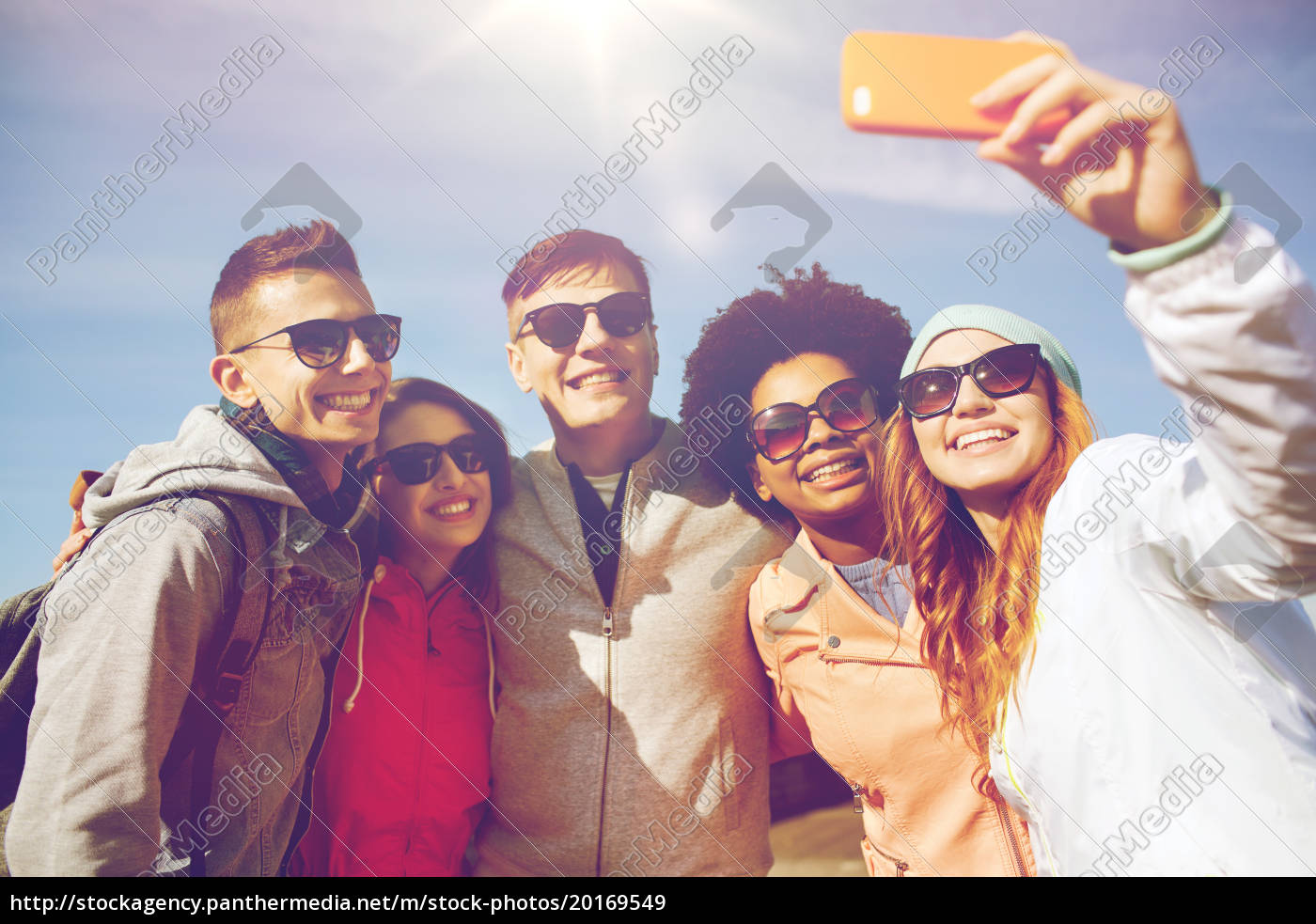 smiling, friends, taking, selfie, with, smartphone - 20169549