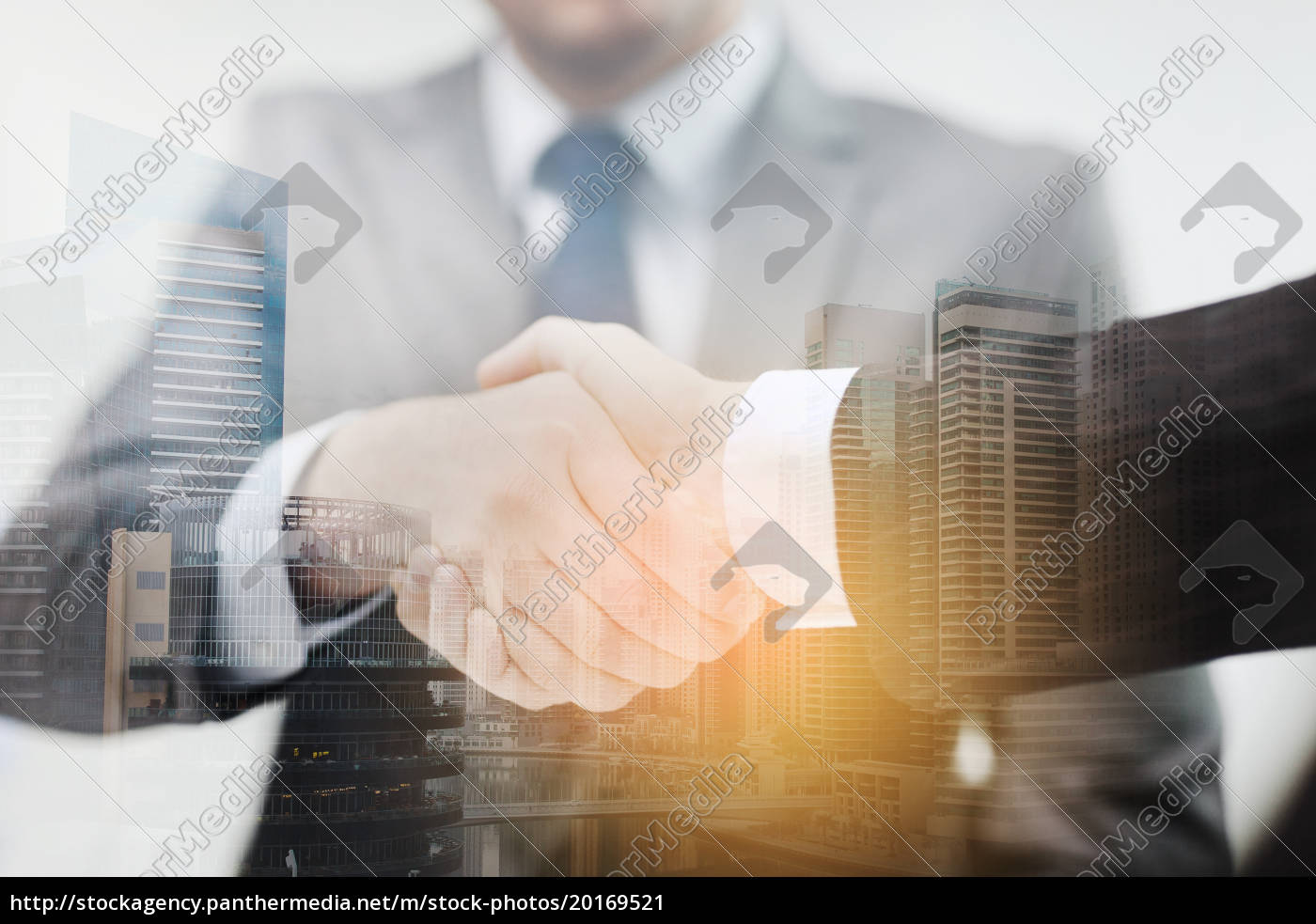 two, businessmen, shaking, hands, in, office - 20169521