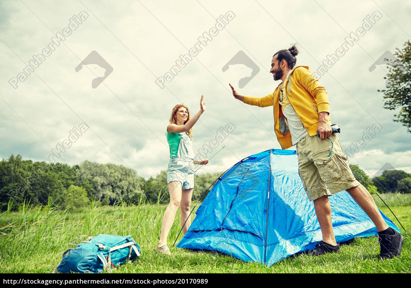 happy, couple, setting, up, tent, outdoors - 20170989