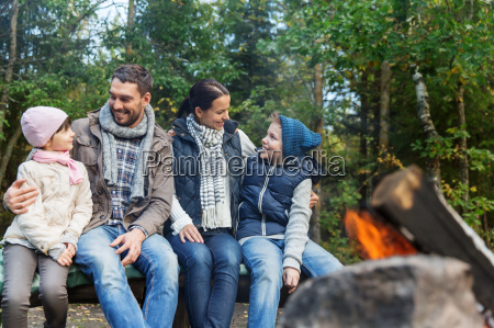 happy, family, sitting, on, bench, at - 20170863