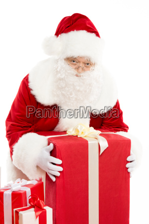 santa claus with pile of christmas