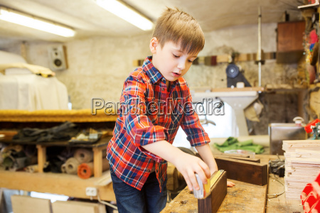 happy little boy with plank and