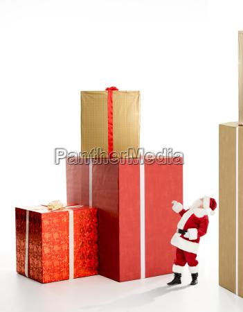 santa claus near big gift boxes