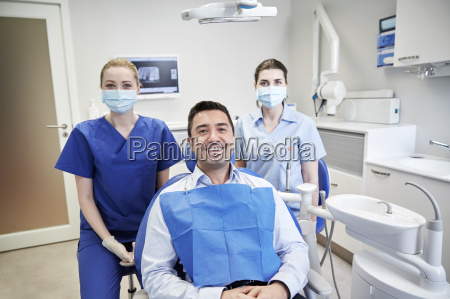happy, female, dentists, with, man, patient - 20171829