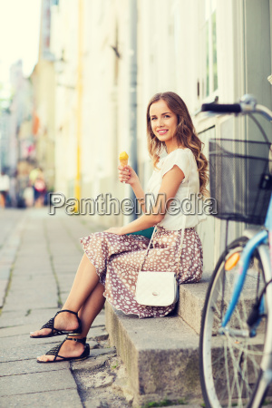 happy, hipster, woman, with, bike, eating - 20171769