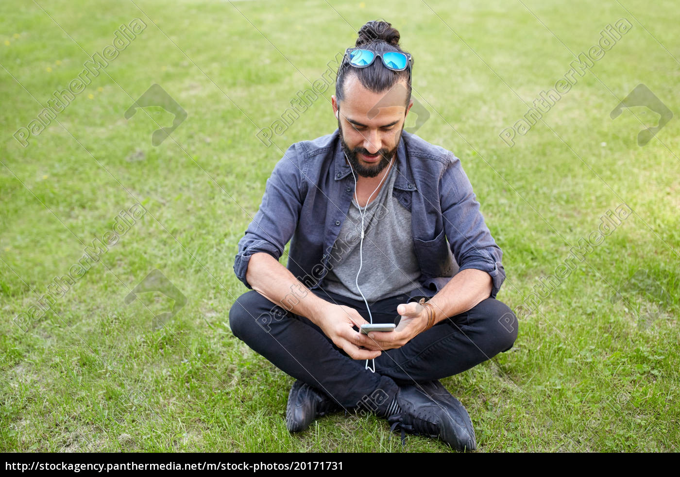 man, with, earphones, and, smartphone, sitting - 20171731