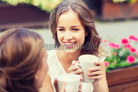 smiling, young, women, with, coffee, cups - 20171343