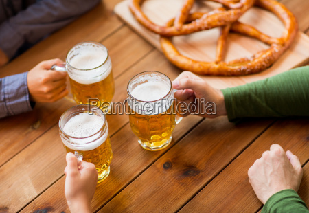 close, up, of, hands, with, beer - 20172013