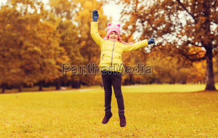 happy, little, girl, jumping, outdoors - 20172447