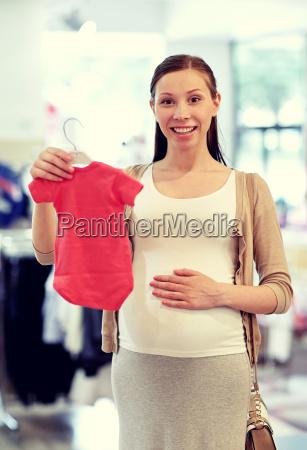 happy, pregnant, woman, shopping, at, clothing - 20172303