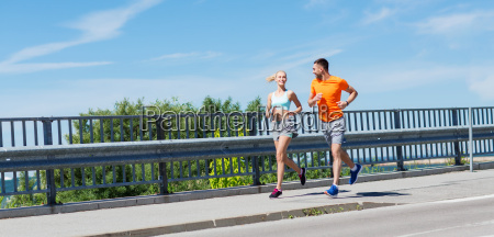 smiling, couple, running, at, summer, seaside - 20172577