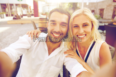 happy, couple, taking, selfie, at, restaurant - 20174567