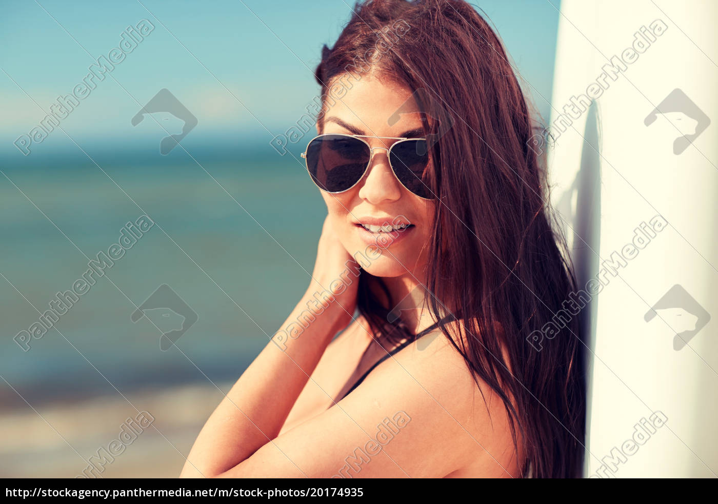 smiling, young, woman, with, surfboard, on - 20174935