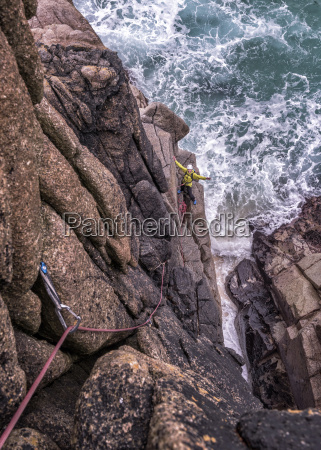 uk cornwall woman with outstretched arms