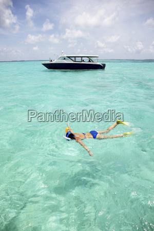 maldives maafushi island woman snorkeling