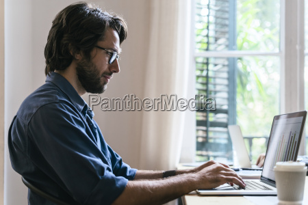 businessman sitting in office working at