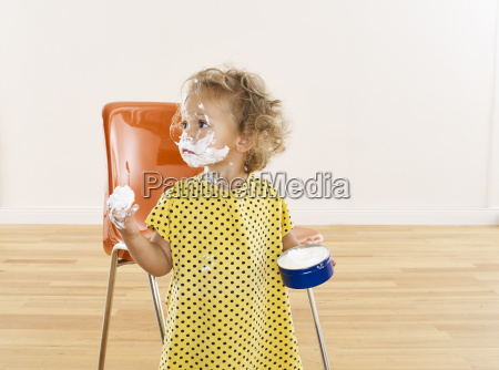 little girl with cream on her
