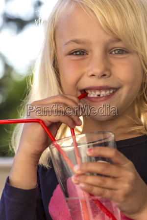 little girl drinking water with drinking