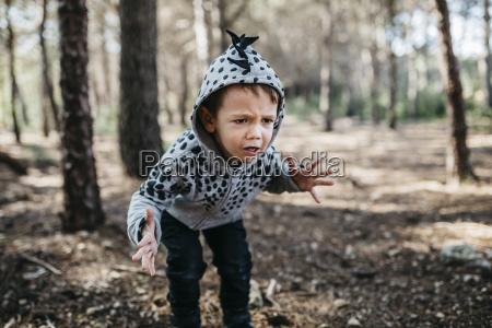 portrait of little boy wearing hooded