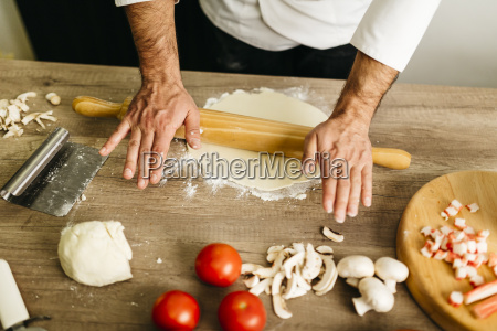 chef preparing pizza