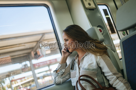 woman on a train talking on