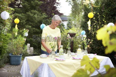 mature woman decoration garden table for