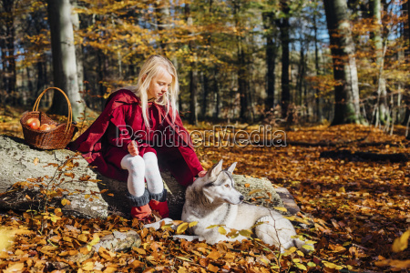 red riding hood girl sitting on