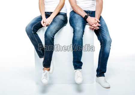 couple sitting in jeans and white