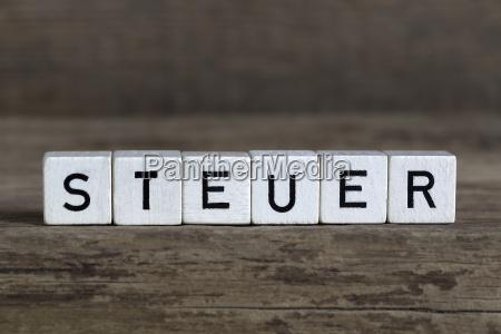 german word tax written in cubes