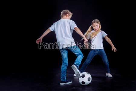 brother and sister playing with soccer