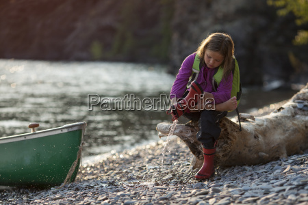 young girl throwing water from the