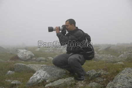 male photographer taking picture of mount